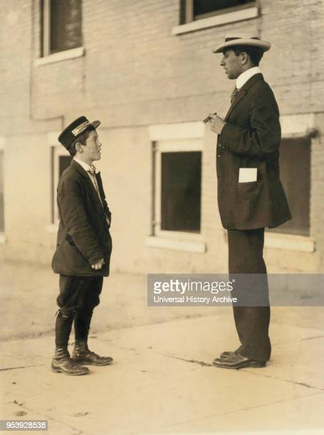 ADT Boy 13 years Portrait Standing Facing Man Burlington Vermont USA Lewis Hine for National Child Labor Committee September 1910