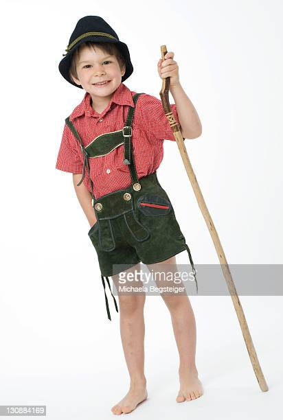 boy, 4 years old, in traditional costume, with walking cane - baviera foto e immagini stock