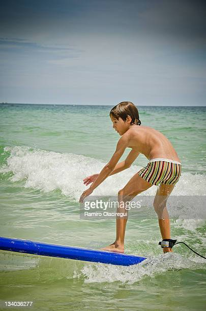 Boy 8-9 surfing. Surf on Caribe.