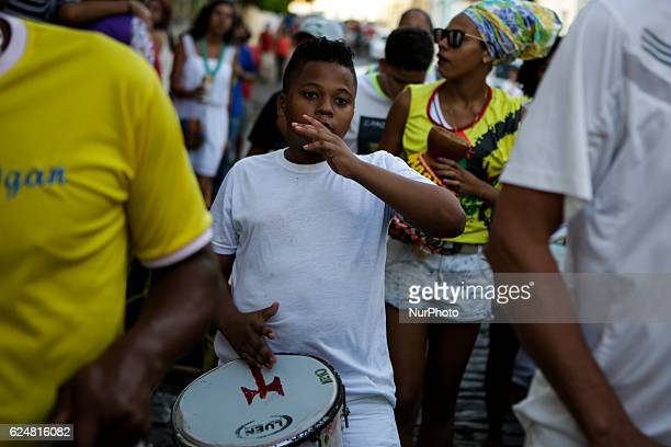 A boy a member of the AfroBrazilian music group plays a percussion during the presentation Afrodescendent musical groups make a presentation in honor...