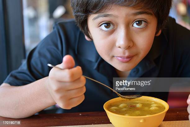 Boy about to enjoy a bowl of soup for lunch