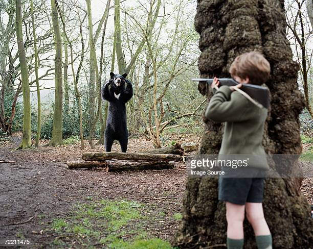 Boy about to shoot a bear