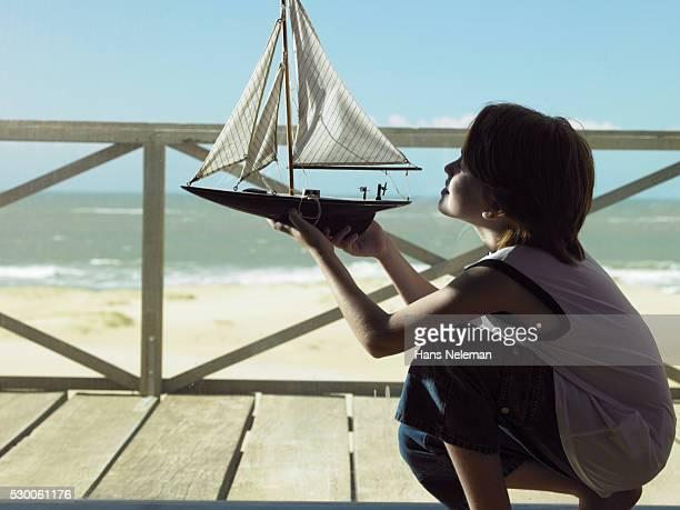 Boy Admiring Toy Boat