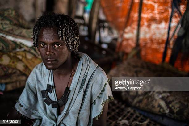 Boy Afar on the market Assayta with the traditional curly hair and scarred forehead, Danakil depression