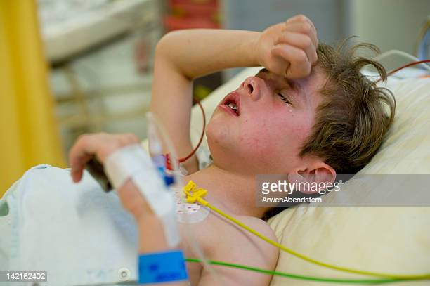 boy after operation in hospital - child hospital stock pictures, royalty-free photos & images