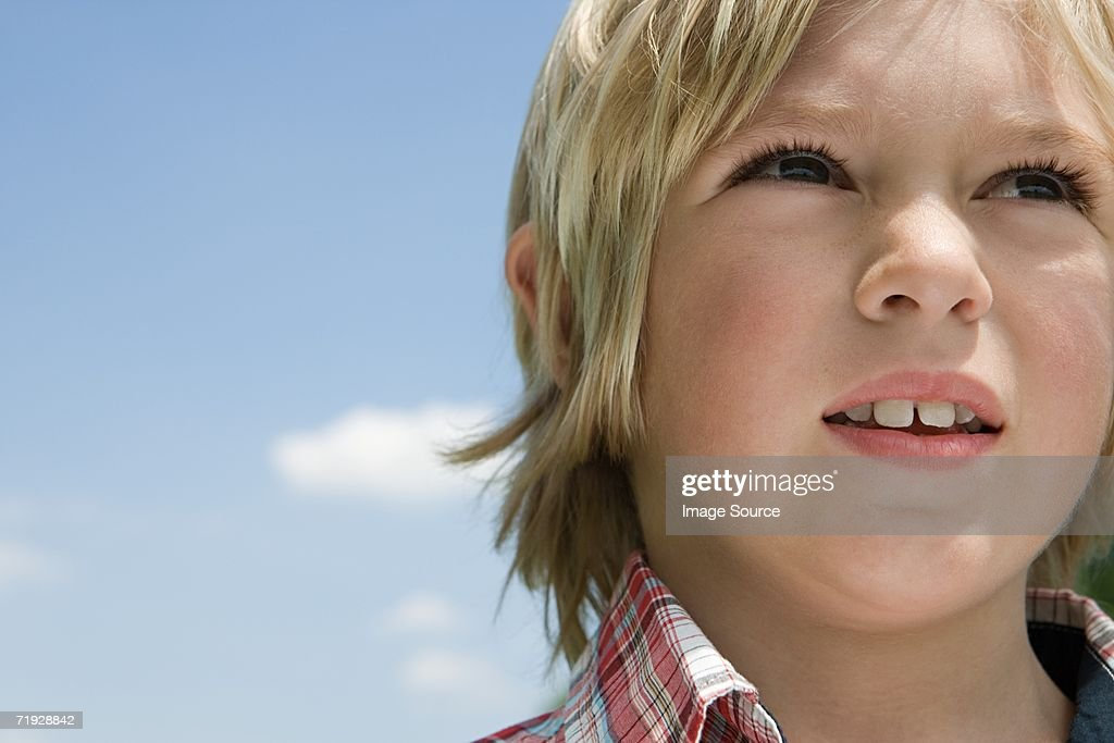 Boy against the sky : Stock Photo