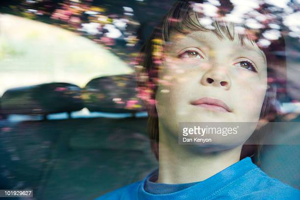 boy aged 10 in car. - one boy only stock pictures, royalty-free photos & images