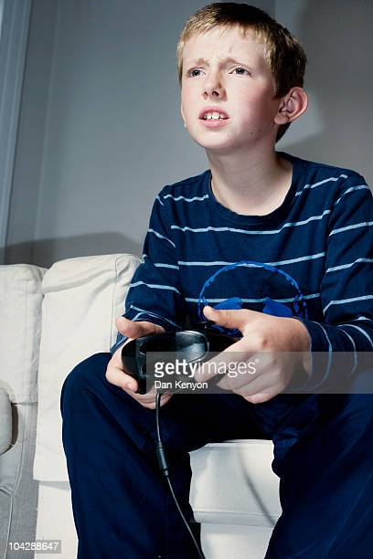 Boy aged 10 playing on games console