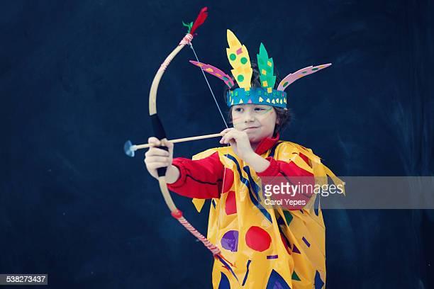 Boy aiming bow and arrow