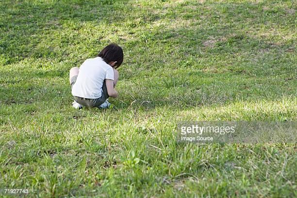 Boy alone in a field