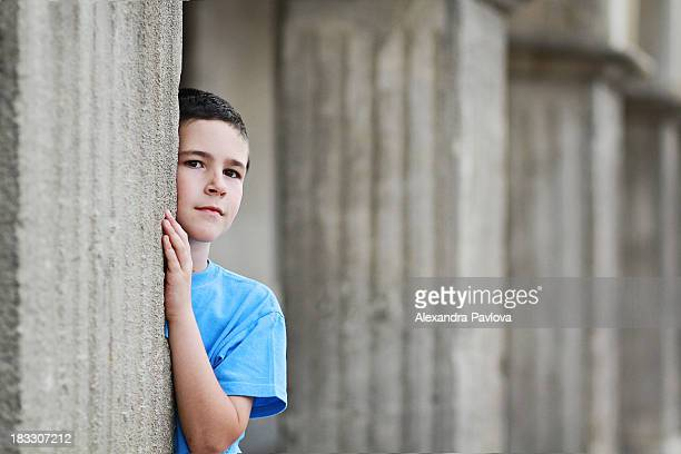 boy among columns of a building - alexandra pavlova stock pictures, royalty-free photos & images