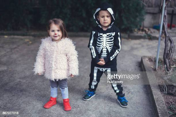 Boy and a girl going on a trick or treat