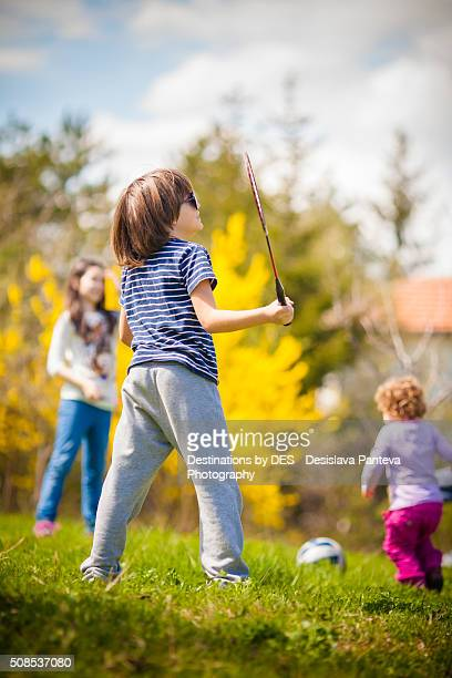 Boy and a girl playing badminton outdoor