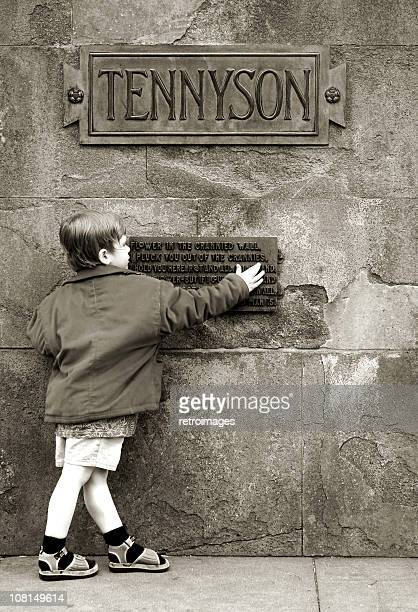 Boy and Alfred Lord Tennyson poetry monument