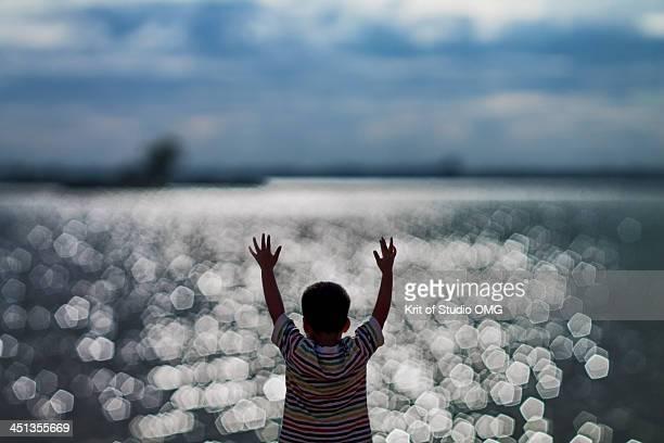 boy and bokeh of the lake - タイ人 ストックフォトと画像