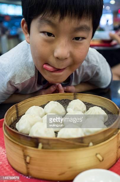 Boy and Chinese xiaolong dumpling