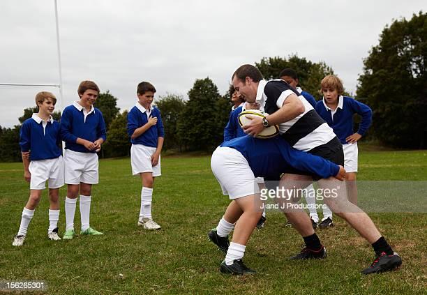 Boy and coach training