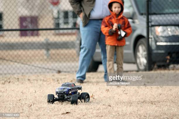 boy and dad with rc car - rc car stock photos and pictures