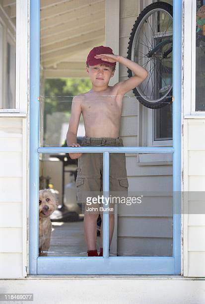 boy and dog on porch