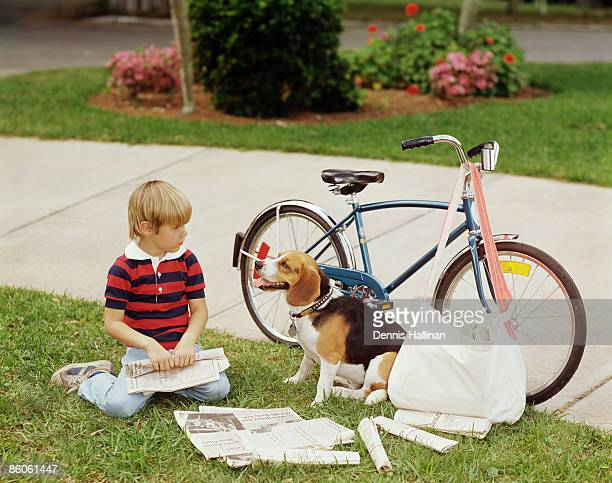 Boy and Dog Preparing to Deliver Newspapers