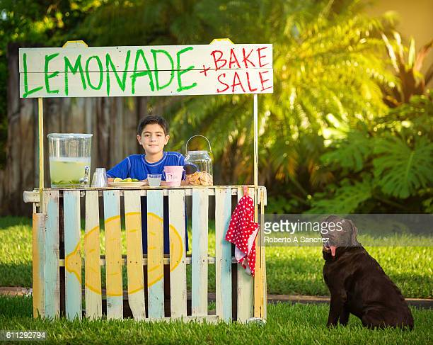 Boy and dog selling lemonade