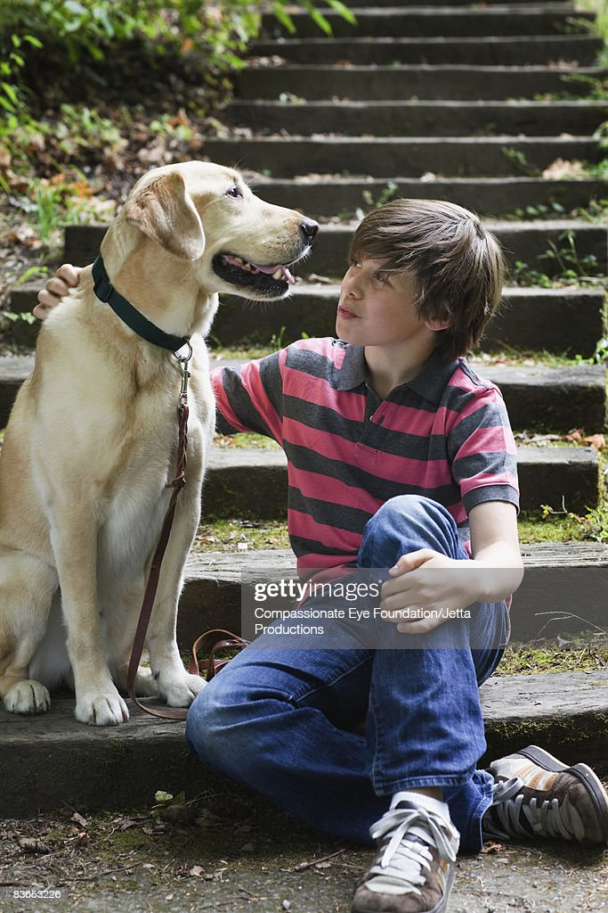 Boy and dog sitting on steps : Stock Photo