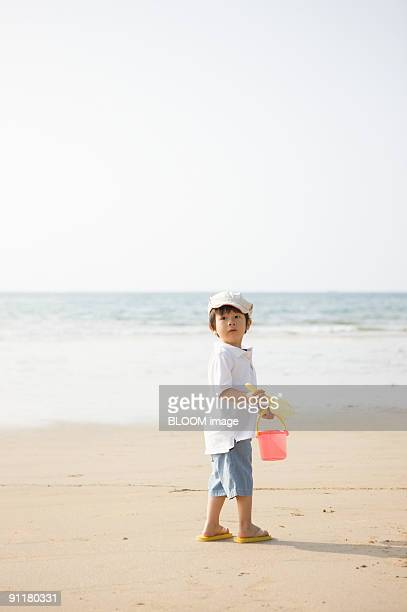 Boy and father at beach