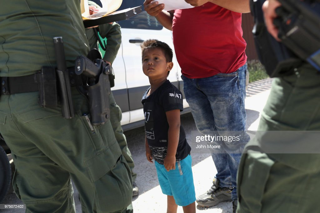A boy and father from Honduras are taken into custody by U.S. Border Patrol agents near the U.S.-Mexico Border on June 12, 2018 near Mission, Texas. The asylum seekers were then sent to a U.S. Customs and Border Protection (CBP) processing center for possible separation. U.S. border authorities are executing the Trump administration's 'zero tolerance' policy towards undocumented immigrants. U.S. Attorney General Jeff Sessions also said that domestic and gang violence in immigrants' country of origin would no longer qualify them for political asylum status.