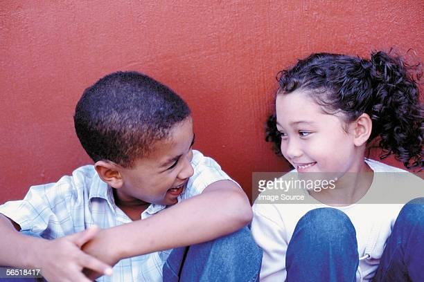 Boy and girl against wall