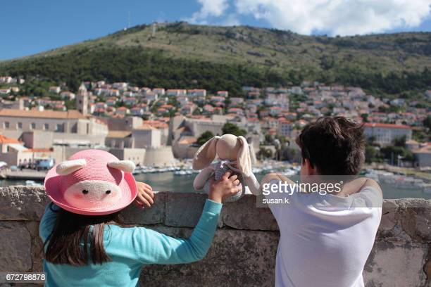 Boy and girl are looking at the beautiful townscape.
