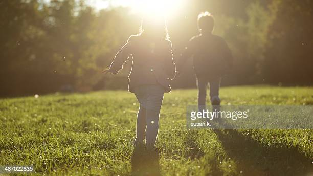 Boy and girl are running towards the light.