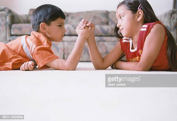 Boy and Girl Arm Wrestling