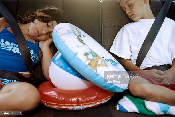 Boy and Girl Asleep in Car