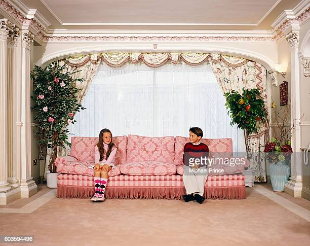 Boy and Girl at Opposite Ends of Sofa