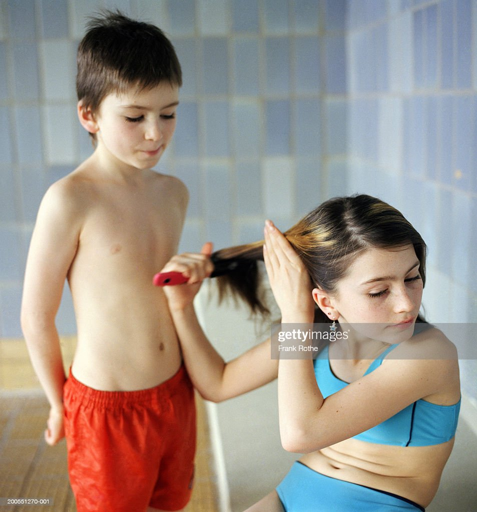 Boy And Girl At Pool Changing Room Girl Combing Hair Stock -3442