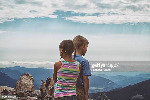 boy and girl at top of Mount Evans