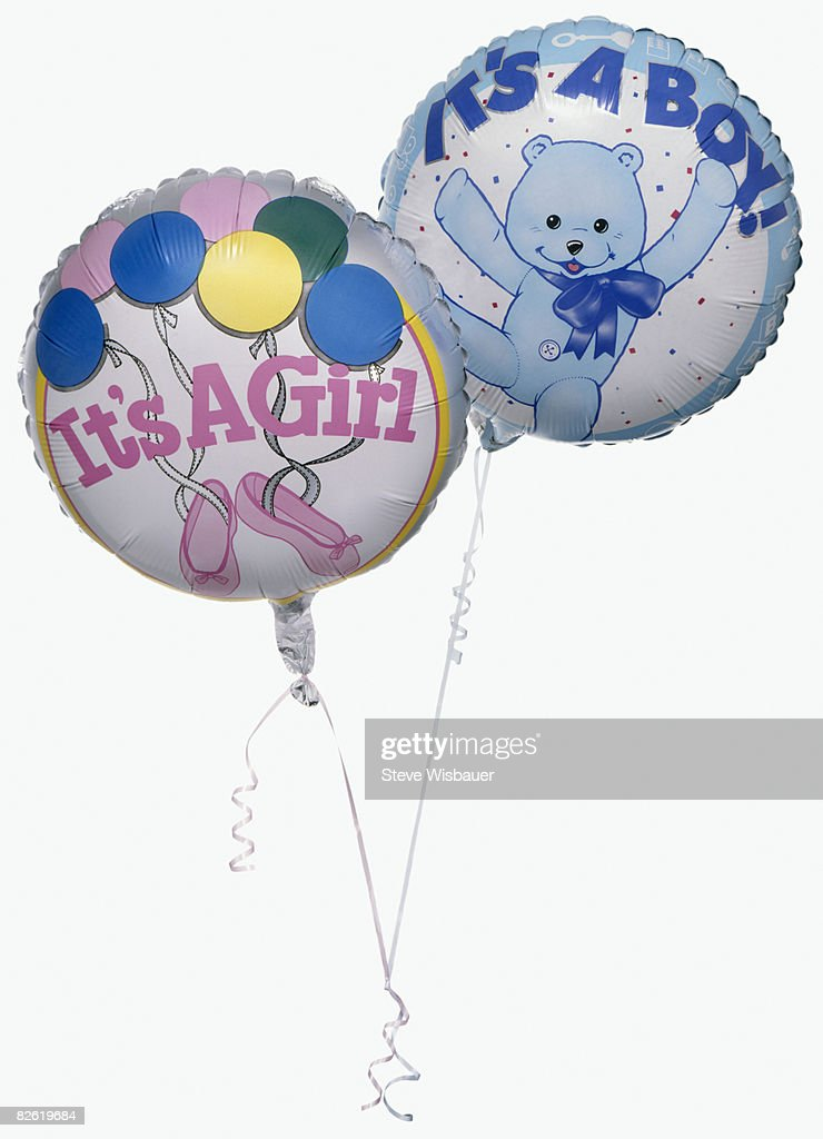 boy and girl balloons  : Stock Photo
