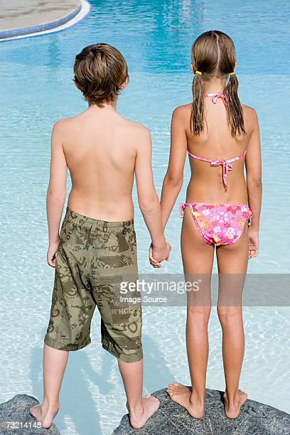 Boy and girl by swimming pool