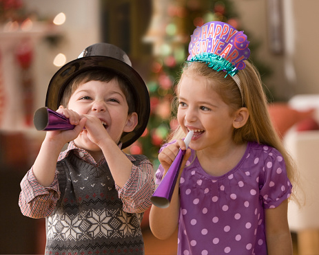 Boy and girl celebrating New Year's Eve - gettyimageskorea