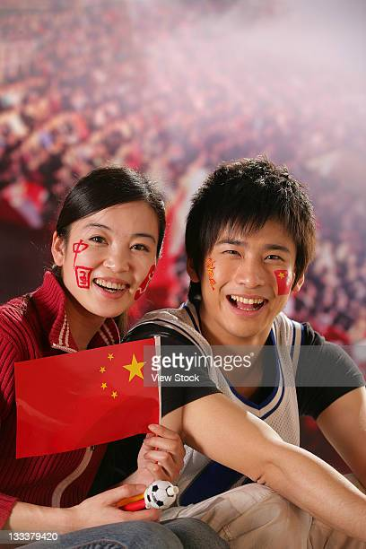 boy and girl cheering together