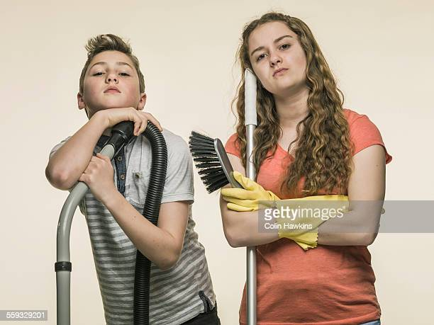 boy and girl doing domestic chores - kids with cleaning rubber gloves stock pictures, royalty-free photos & images