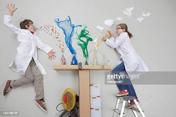 Boy and girl doing experiment