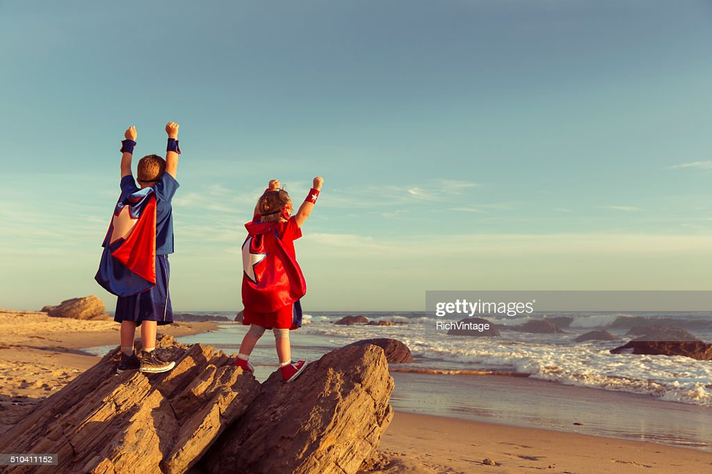 Boy and Girl dressed as Superheroes on California Beach : Stock Photo