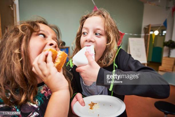 boy and girl eating cake - see stock pictures, royalty-free photos & images