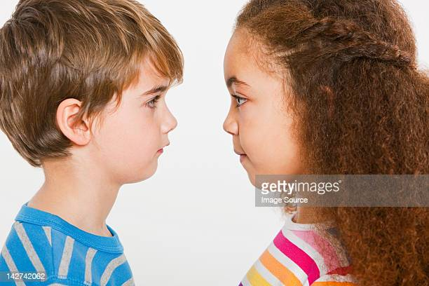 boy and girl face to face - face to face stock pictures, royalty-free photos & images