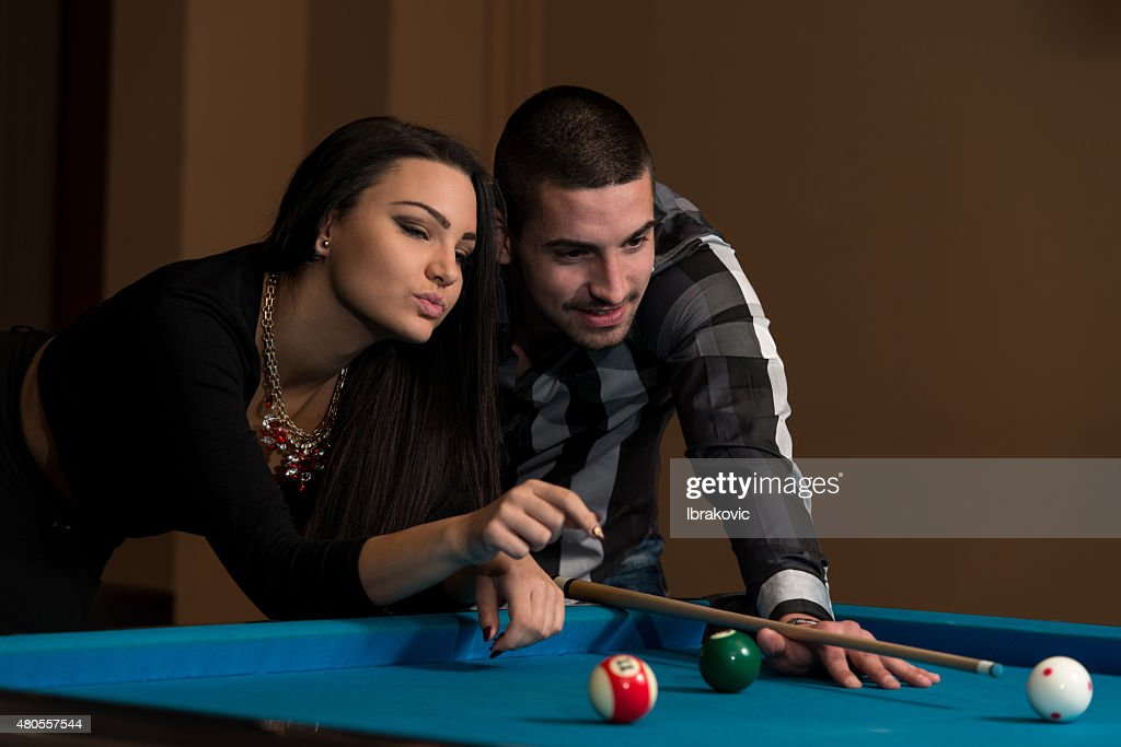 Boy And Girl Flirting On A Pool Game : Stock Photo