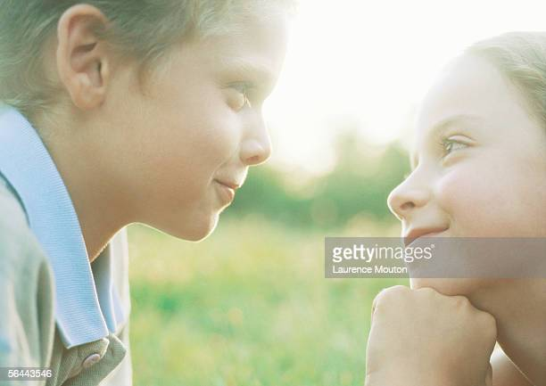 boy and girl gazing into each other's eyes - 見つめる ストックフォトと画像