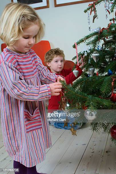 Boy and girl hanging christmas decorations