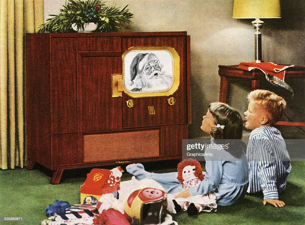 Boy and girl happily watching Santa Claus on television on Christmas day; photograph, 1950.