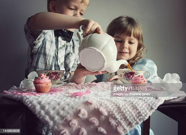 Boy and girl having a tea party